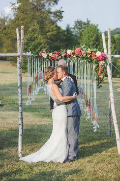 ceremony kiss - photo by Teale Photography http://ruffledblog.com/colorful-boho-wedding-at-historic-cedarwood