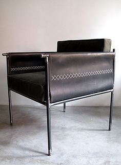 Casa Midy. I love the leather! the white stitching and the straight lines of this chair