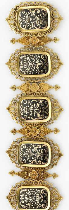 An antique black enamel and fourteen karat gold bracelet comprising six enamel and gold plaques in a stylized fluer-de-lys design, framed by granulated openwork scrolls, accented with alternating granulated gold floral spacers; with French import mark