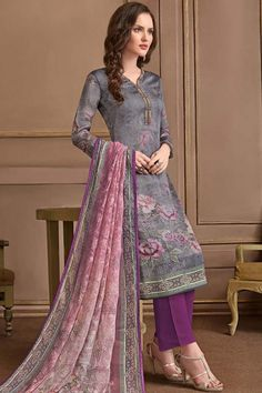 This Grey Georgette Trouser Suit which makes it astonishingly charming. Present with Santoon Trouser in Purple Color with Multi Colour Printed Georgette Dupatta.