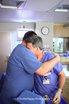 """The doctor was the same doctor who delivered Klayton and had experienced the immense loss nearly a year before. This photo is from the birth of their miracle """"Rainbow Baby"""" when Dad and Dr. Hodges embraced and cried. """"That is still the umbilical cord in the doc's hands to tell you how immediately this happened after delivery,"""" Sarah says."""