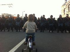 Thousands of Russians in Moscow marched and rioted in protest of Vladimir Putin's inauguration. This photo, snapped by Jessica Ioffe, shows a little boy on a bicycle staring down Russian riot police armed. This photo has reportedly become a symbol for the Russian protesters.