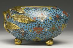 A RARE CLOISONNE PEACH-FORM CENSER QING DYNASTY, KANGXI PERIOD the rounded sides enameled with red, yellow, blue and white classic lotus scroll within the gilt wire cloisons against a turquoise ground, all raised on three small peach-form feet and with a gilt metal peach bough forming the handle