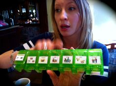 Arielle holding pill box... Use a pill box to have loved one complete a task and then once task is completed, they get a small reward when they open the top to show completion.