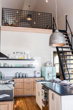 A challenge with adding the loft was where to locate stair access. Chip came to the rescue with specialized retractable stairs that can be raised and lowered drawbridge style. When the loft is not being used, the stairs can be raised to a storage position where they hang suspended about 10 feet above the kitchen.