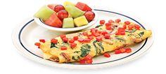 A healthy meal loaded with spinach, mushrooms, onions and Swiss cheese with diced tomatoes on top from the SIMPLE & FIT menu at IHOP. Under 600 calories.