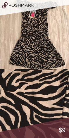Zebra print, silky romper. Cute, comfy, and cool silk romper. You can wear over shoulders or on top like a normal shirt top. Does have a tie in waste area. New with tag. Tag says XL but it does run small. :) Other
