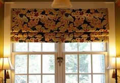 DIY faux Roman shade using 3 spring tension rods. What a great idea!