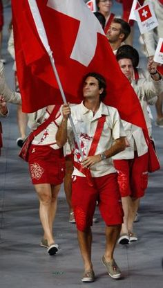 Olympics 2012~                                                                                                                       Roger Federer carrying Swiss Flag