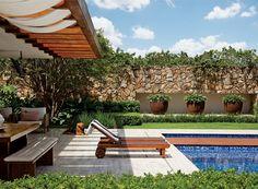 Jardim integra living, espaço gourmet e quartos