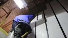 A worker finishing up the UX installation in the tight space of a new storage closet. blog.InSoFast