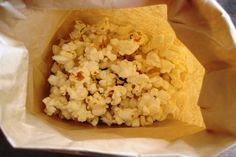 Low cholesterol microwave popcorn; substitute olive oil for butter.