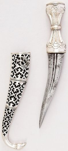Indian khanjar dagger, 18th to 19th century, steel, silver, wood, H. with sheath 10 1/8 in. (25.7 cm); H. without sheath 8 5/8 in. (21.9 cm); H. of blade 5 1/4 in. (13.3 cm); W. 1 5/16 in. (3.3 cm); Wt. 6.3 oz. (178.6 g); Wt. of sheath 3.4 oz. (96.4 g), Met Museum, Bequest of George C. Stone, 1935.