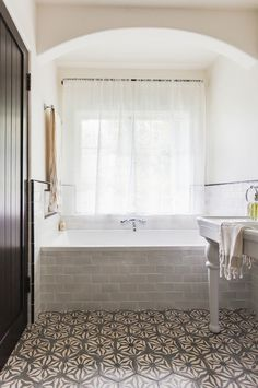 The juxtaposition between clean and classic subway tiles and the Moroccan-influenced floor tiles create interest in an otherwise neutral space.
