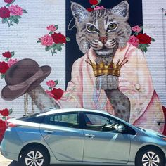 Let's make #raleigh #colorful Love this mural on the side of @cgracebar & @empressroombar off #glenwoodsouth @lisagaitherart knocked this one out of the park. You can hear the #prrr of the #cat but not the #Prius (it's silent!) #triprius #herekittykitty #meow
