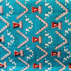 Tissu en coton à motifs géométriques rouge et blanc sur fond bleu