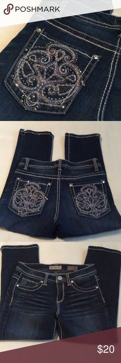 NWOT Nine West American Vintage dark blue capris In perfect condition, I never wore them...crystal studs with back pocket detail. I'm 5'3 and they hit mid calf. Very cute and stretchy. NINE WEST VINTAGE Jeans