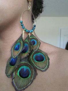 peacock feather earrings  I think I can make something similar.