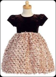 A flurry of delicate ribbons define this enchanting champagne holiday dress with a cap sleeve, chocolate brown velvet bodice, tie back sash and a skirt that is adorned with shimmering sequins. A lovely choice for her holiday and Christmas events.