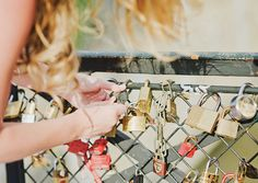 I think this is such a cute idea! Couples attach a lock with their last name onto the bridge after they tied the knot and throw the key into the river, symbolizing their everlasting commitment.