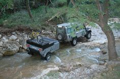 Landrover with offroad trailer in river