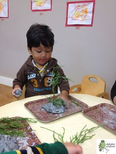 We decided to incorporate bits of nature with our natural clay for a great sensory/motor skills experience.
