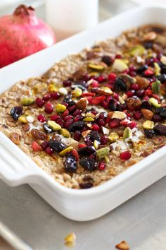 Saffron Pear Baked Oatmeal Recipe-Eggless - Made with bananas and coconut milk for liquid, coaches oats, raisins and cinnamon. Served with honeyed greek yogurt and fresh berries. Both Ally & Jason loved it.