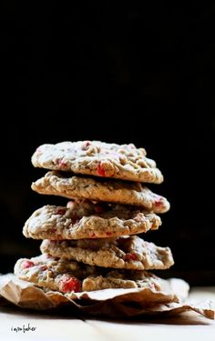 Cherry flavored morsel Oatmeal Cookies: The best oatmeal cookie recipe EVER!  Ingredients        1 1/2 cups flour      1 tsp baking soda      1 tsp baking powder      1 tsp salt      2 tsp cinnamon      1/2 tsp all spice      1 tsp cocoa      1 1/2 cups whole oats      1 1/2 cups Cherry flavored baking morsels      2 large eggs      1 tsp vanilla      1/2 cup shortening      1/4 cup room temp butter (unsalted)      3/4 cup brown sugar      3/4 cup white sugar