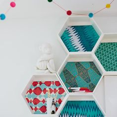 """When designing these shelves, we thought it was a great idea to make them a unique shape that can be oriented in any direction. We thought it was a bad idea to include a complimentary bee colony. Details, details Nod exclusive Features three connected hexagonal shelves Each shelf is 4"""" deep and 11. 5""""W x 10""""H Hang multiple shelves to form a giant honeycomb shelving unit Can hold up to 50 lbs."""
