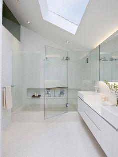 Love the sky light & sloping roof.  Beautiful bathroom