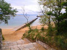 Steps down to Playa do los Bikinis on the Magadalena Peninsula in Santander, Spain