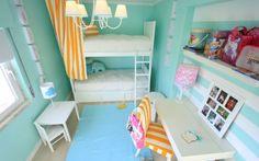Bunk beds blue rug floating desk shelves modern girls bedroom with