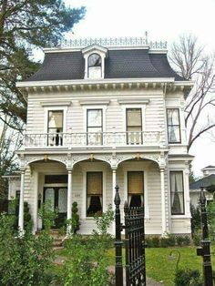 Like the trim details & black-painted window sashes & muntins on this Victorian home.