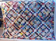 four patch scrappy quilt