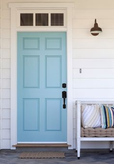 front door painted with Benjamin Moore's Tranquil Blue - via Atticmag