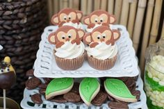Gold Toned Jungle Safari themed birthday party via Kara's Party Ideas KarasPartyIdeas.com Cake, supplies, favors, cupcakes, banners, invitation, and more! #safari #jungle #junglesafariparty #zooanimals #safariparty (10)