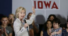 """ANKENY, Iowa  — Standing in front of a tractor in the Des Moines Area Community college's """"John Deere Exhibition Hall,"""" Hillary Clinton was a world away from the lavish beach vacation in the Hamptons where the Democratic frontrunner has been recharging since late last week. There, she has been enjoying the luxe life: celebrity..."""