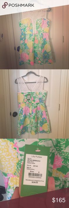 Lilly Pulitzer Raegen Dress- Hibiscus Stroll BRAND NEW! This dress is absolutely adorable with original tags still attached. Colors are fun and vibrant! Lilly Pulitzer Dresses Midi