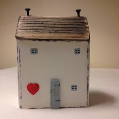 Home is where the heart is. #driftwood  #hmuk  #handmade  #cottages  #shabbydaisies  #heart #valentine  #littlehouses  #littlecottage  #woodencottage  #house #wooden