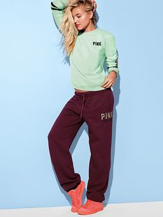 "Campus Pant PINK JH-324-076 (G45) 44.95 A comfy must-have to live, love and lounge in: it's our Campus pant. Banded bottomwith a relaxed straight fit and cute graphics. Must-have sweats by Victoria's Secret PINK. Relaxed, easy fit Print graphics Banded bottom Cozy, supersoft fleece Elastic drawstring waist Side pockets 33"" inseam Imported cotton/polyester"