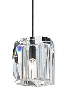 Elegance takes form in this hand-carved solid crystal pendant inspired by current trends of asymmetrical facets in home accessories and jewelry.