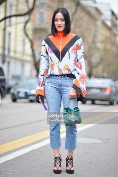 Tiffany Hsu poses wearing an Emilio Pucci shirt and Paula Cademartori bag before the Fendi show during the Milan Fashion Week Fall/Winter 2016/17 on February 25, 2016 in Milan, Italy.