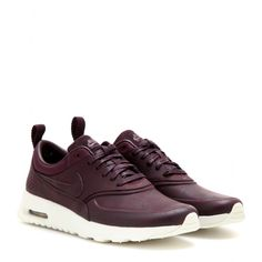 Nike - Nike Air Max Thea Premium sneakers -  The deep bordeaux hue looks striking next to the stark white rubber sole. - @ www.mytheresa.com