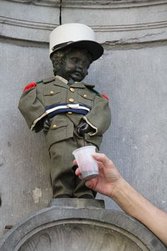 Looking for extreme experiences in Brussels? Then drink wine directly from the Manneken-Pis