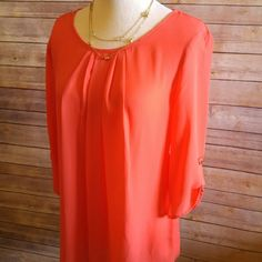 "Coral pleated front blouse with gold buttons Brand new! Perfect for the office and can also be easily dressed down. Polyester. Slightly sheer. Flowy and comfortable.   Picture 4 for styling inspiration only.  Medium: 19"" approx bust measurement. 27"" length. Large: 20"" approx bust. 28"" length. boutique Tops Blouses"