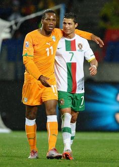 Didiar Drogba (Ivory Coast) with Cristiano Ronaldo (Portugal) - #WorldCup
