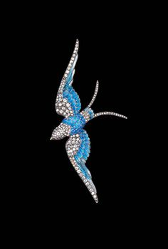Blue Bird, circa 1880. Anton Lachmann, Austria. 14kt yellow gold, silver, enamel, rubies, and diamonds. Photo: Museum of Arts and Design, New York, courtesy Bowers Museum