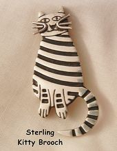 http://www.rubyplaza.com/item/650016-2180/Adorable-Pussycat-925-Sterling-Brooch
