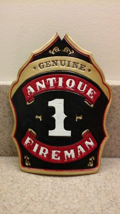 Custom hand made, hand painted fire helmet shield/front.