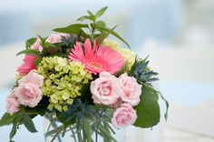 Sweet Pink Centerpiece with Gerberas, Spray Roses and Green Hydrangea  http://www.busseysflorist.com/bridal-wedding-flowers/